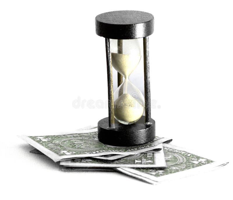 Reloj de arena y dinero imagenes de archivo