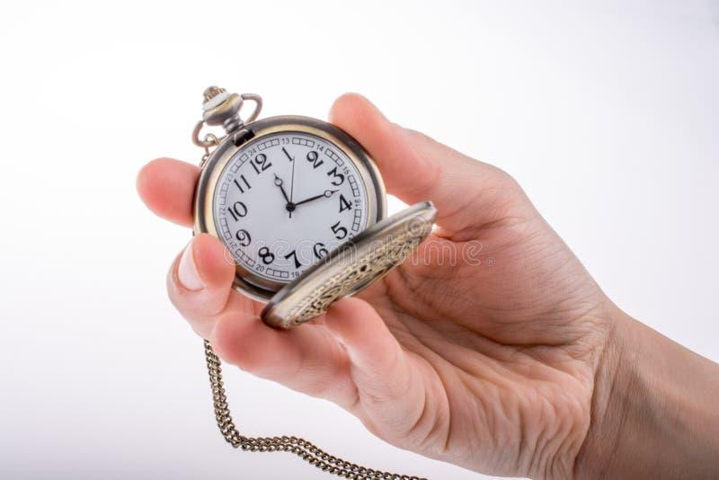 Reloj de bolsillo disponible fotos de archivo libres de regalías