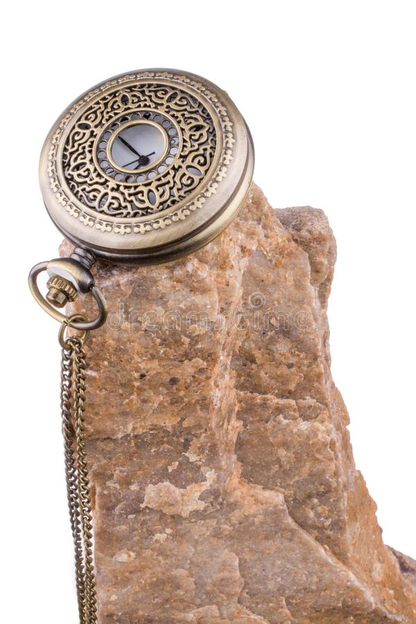 Reloj de bolsillo en roca imagen de archivo