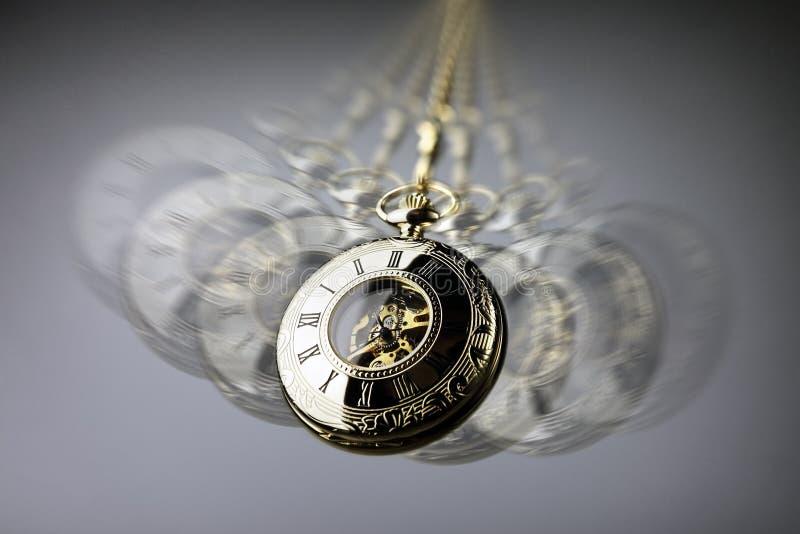 Reloj de bolsillo de la hipnosis imagen de archivo libre de regalías