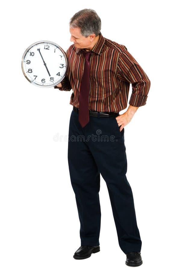 Reloj de la explotación agrícola del hombre de negocios foto de archivo libre de regalías