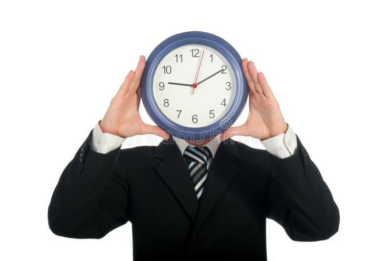 Reloj de la explotación agrícola del hombre de negocios imágenes de archivo libres de regalías