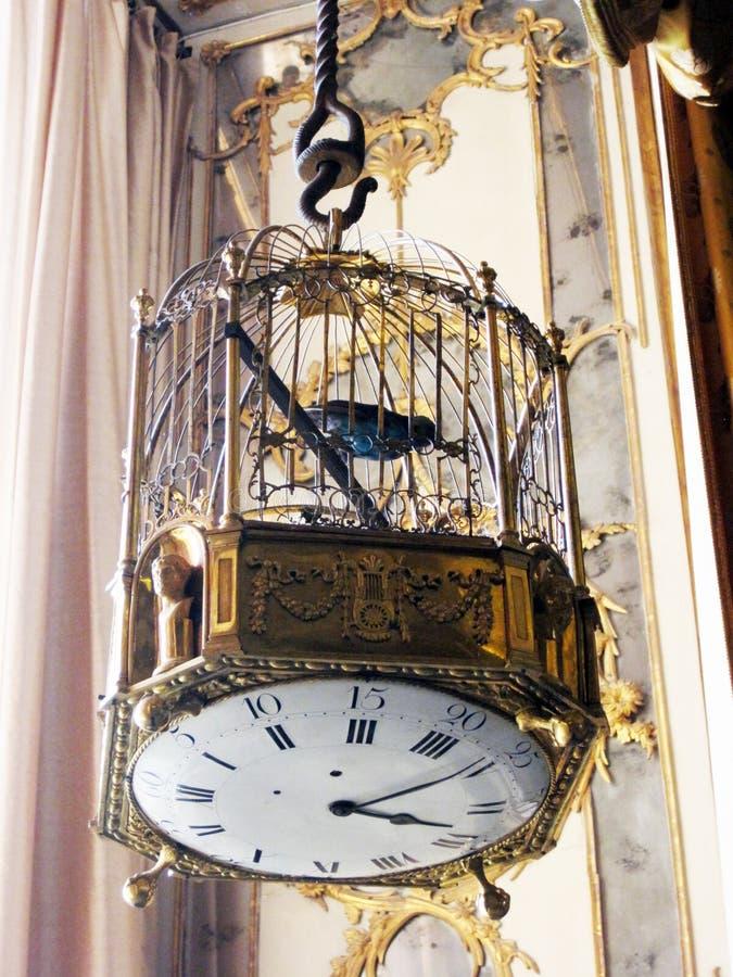 Reloj de la jaula de pájaros foto de archivo