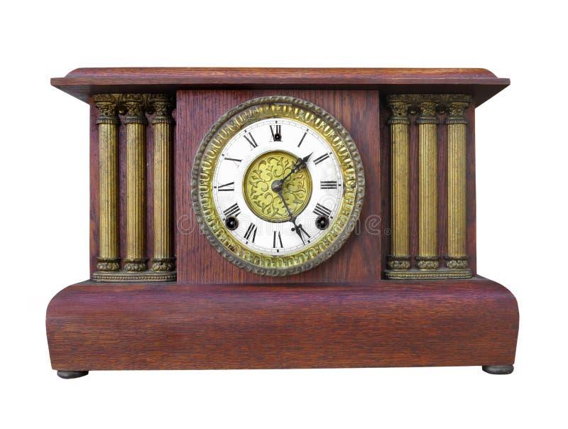 Reloj de madera antiguo de la capa aislado. fotos de archivo libres de regalías