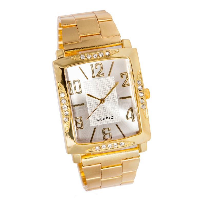 Reloj de oro de la mujer con los diamantes foto de archivo libre de regalías