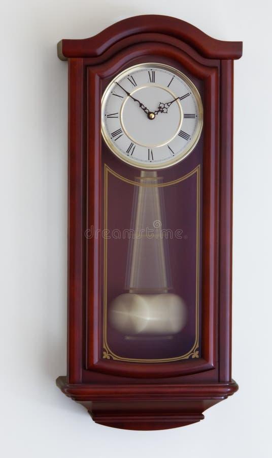 Reloj de péndulo fotos de archivo