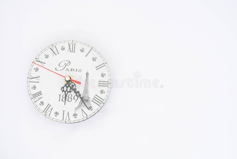 Reloj de pared en un fondo blanco fotografía de archivo libre de regalías