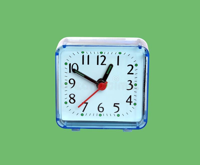Reloj de tabla aislado en verde fotografía de archivo libre de regalías