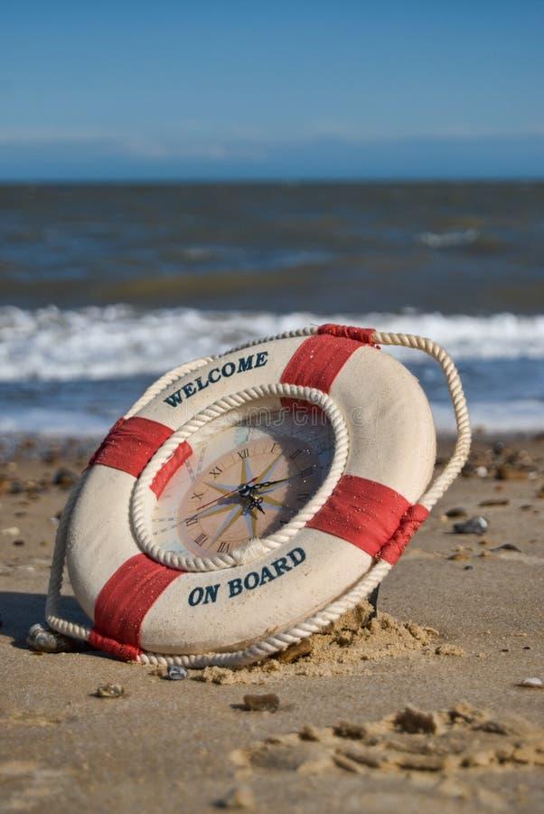Reloj en la playa fotografía de archivo