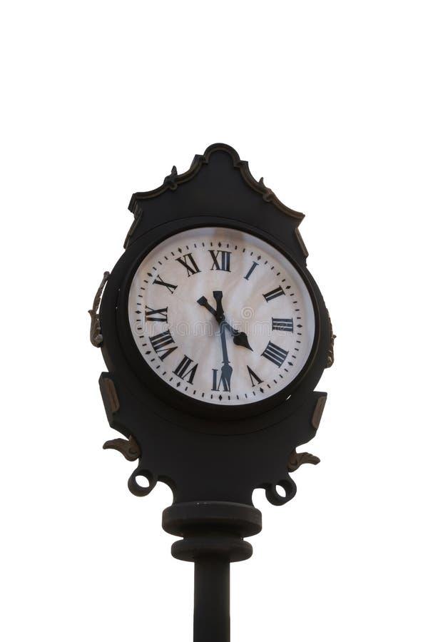 Reloj exterior aislado del vintage con los números romanos que indican 16:30 imagen de archivo libre de regalías