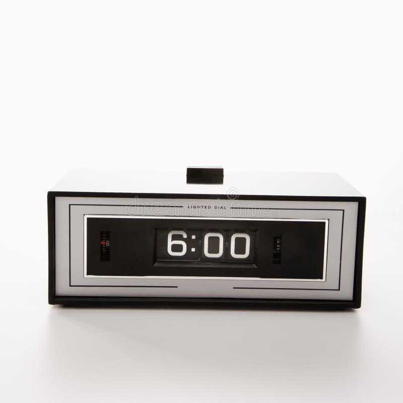 Reloj fijado para el 6:00. imagenes de archivo