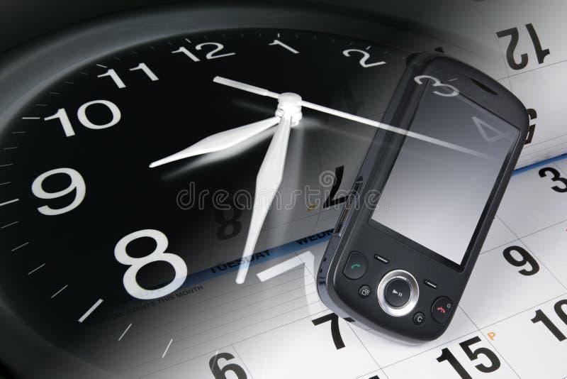 Reloj, teléfono elegante y calendario imágenes de archivo libres de regalías
