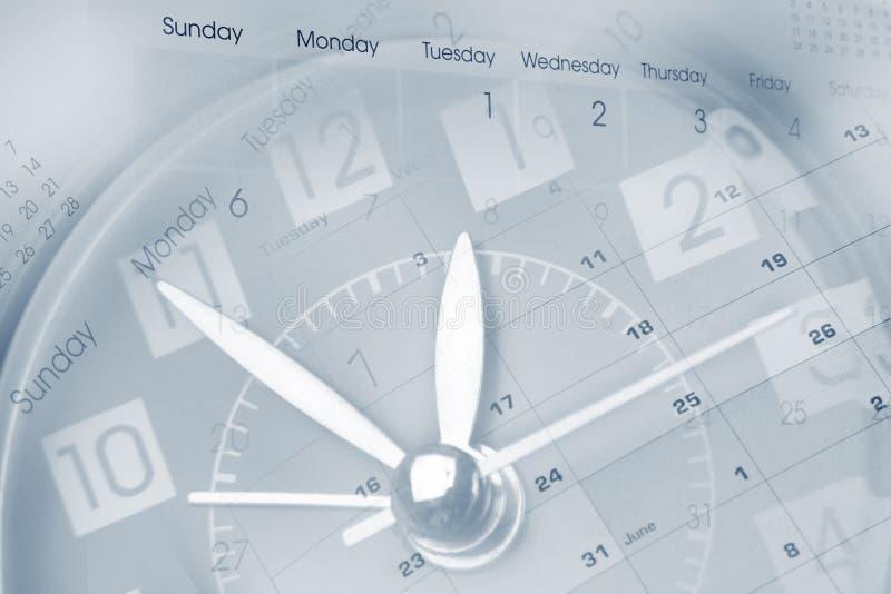 Reloj y calendarios imagen de archivo