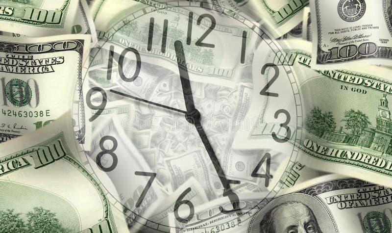 Reloj y dinero imagen de archivo