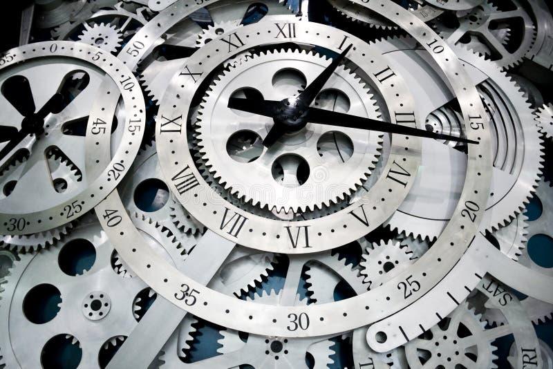 Reloj y engranajes foto de archivo