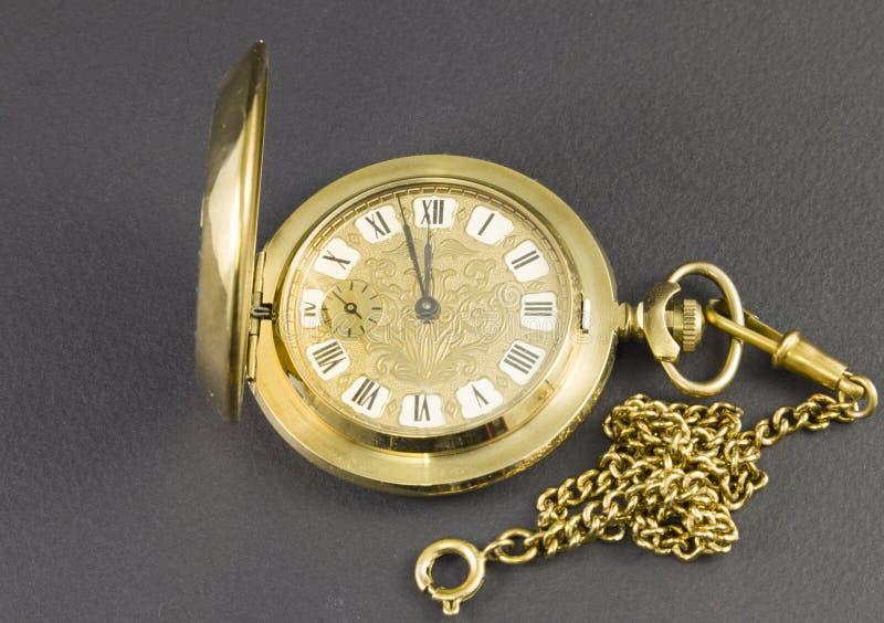 Relojes hechos del metal amarillo fotografía de archivo