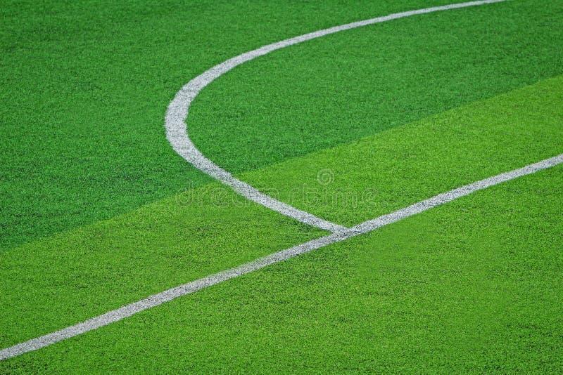 Relvado artificial do campo de futebol do futebol fotos de stock royalty free