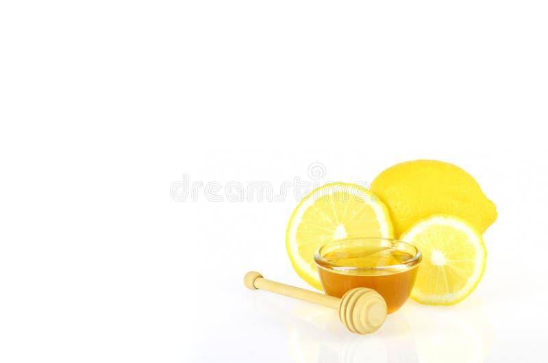 Remédio da homeopatia do mel e do limão imagem de stock