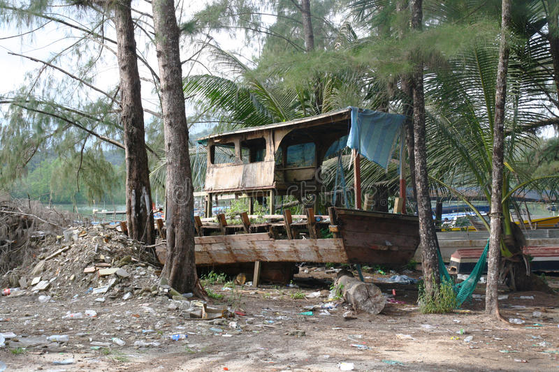 Remain of the fishing boat. Old remain of the fishing boat found on the land near the mangrove area at Langkawi island stock photos