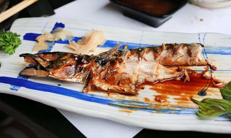 Remain of Grilled Saba fish with teriyaki sauce.  royalty free stock photo