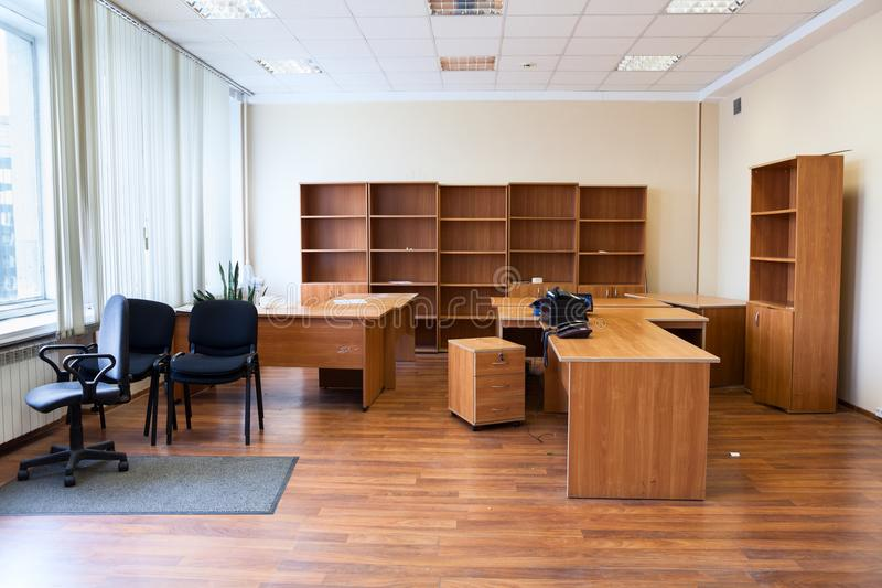 Remaining furniture as tables, chairs and cabinets in empty office after the tenant`s eviction. Remaining furniture as desks, chairs and cabinets in empty office royalty free stock photos