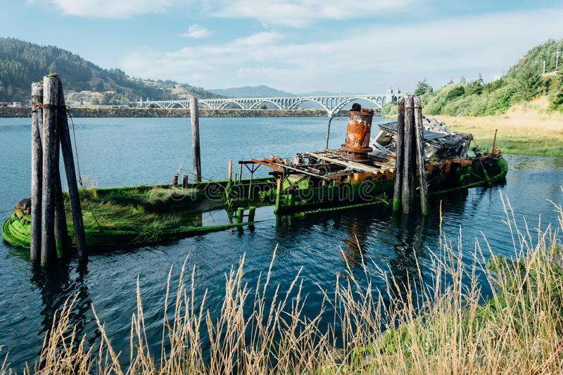 Remains of the abandoned shipwreck of the Mary D. Hume, in Gold Beach OR. Egon, along the Rouge River royalty free stock image