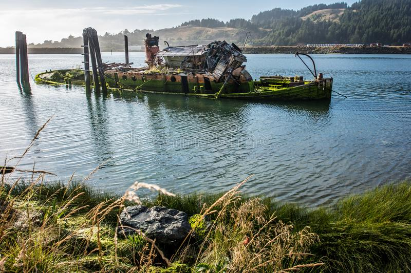 Remains of the abandoned shipwreck of the Mary D. Hume Oregon. Remains of the abandoned shipwreck of the Mary D. Hume, in Gold Beach Oregon, along the Rouge royalty free stock photo