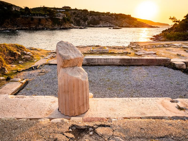 The remains of Aliki ancient marble quarry and marble port, in sunrise light royalty free stock photo