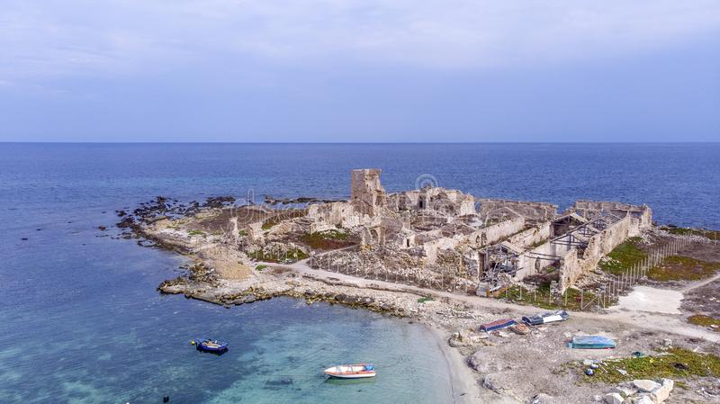 Remains of an ancient Tonnara in Trapani now in disuse. Remains of an ancient Tonnara in Trapani, now in disuse, awaiting restoration royalty free stock images