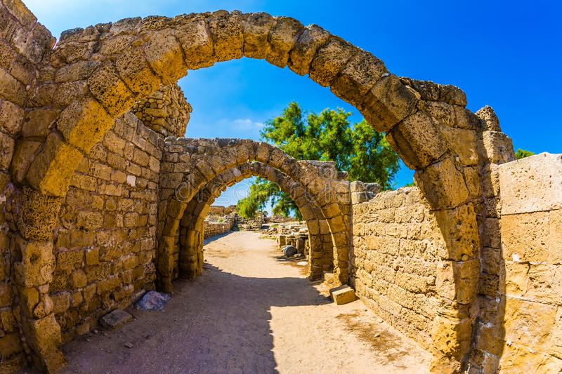 The remains of the arcades. Sunny spring day. Israel. Excursion to the Archaeological Park of the Roman Empire in ancient Caesarea. Concept of ecological and stock photo