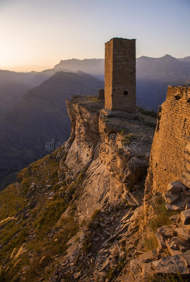 The remains of the aul of the ghost Goor in Dagestan in the evening. Ruins and towers of the aul ghost Goor in Dagestan in the evening light royalty free stock photography