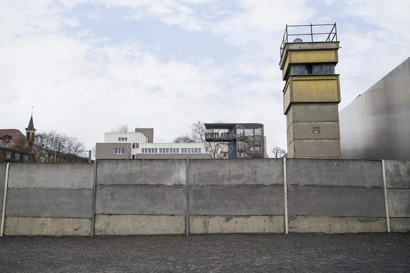 Remains of the Berlin Wall and watchtower. Front view of a section of the original Berlin Wall and watchtower at the Berlin Wall Memorial Berliner Mauer in stock photography