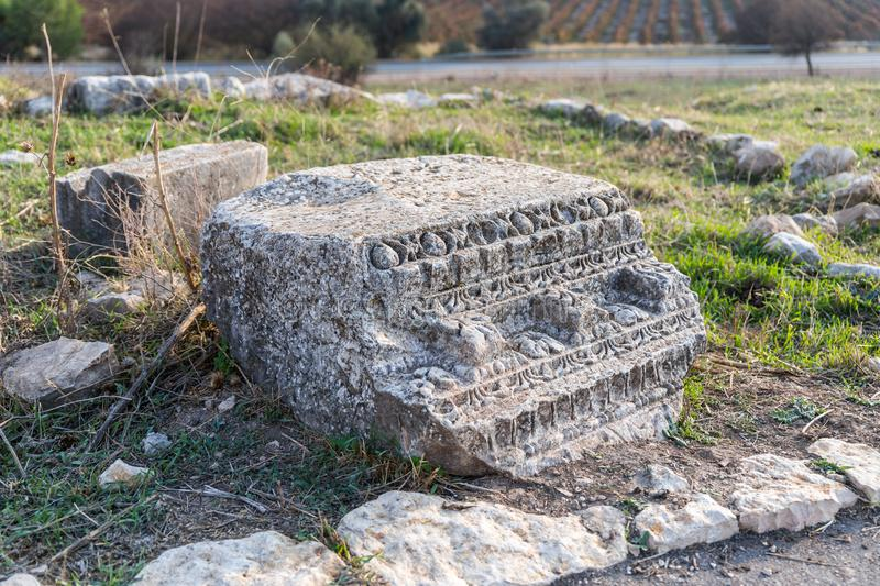 The remains of the column on the ruins of the destroyed Roman temple, located in the fortified city on the territory of the Naftal royalty free stock photography