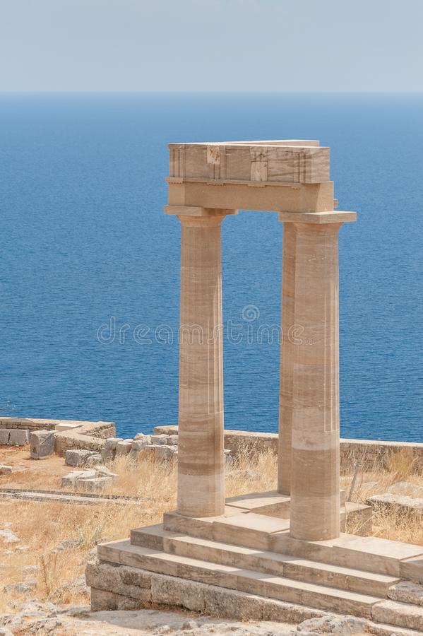 Remains of columns in the Greek Doric Order. Standing on the edge of cliff. Greece royalty free stock photo