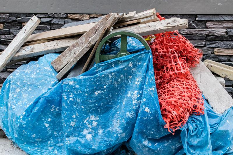 Garbages from a construction - yellow and red colors royalty free stock photos