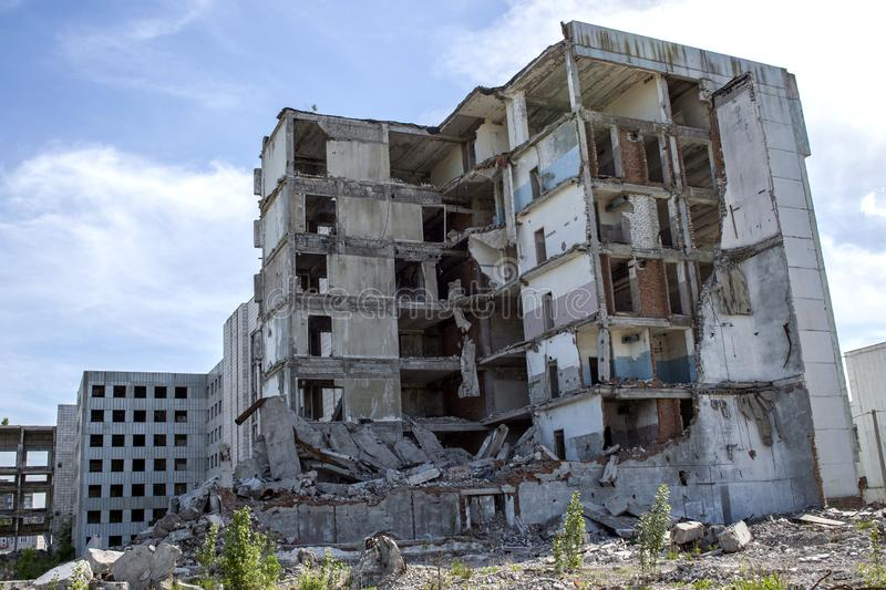 The remains of the destroyed concrete building against the textured blue sky. Background royalty free stock photography