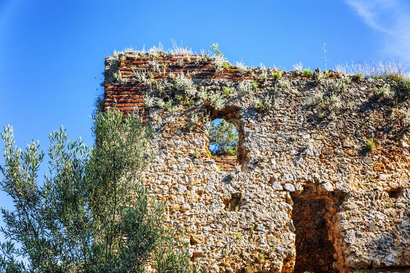 The remains of the fortress wall against the blue sky. Destroyed landmark. Close-up. Space for text royalty free stock images