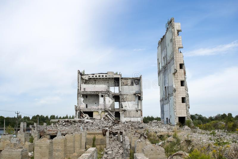 The remains of the Foundation on the background of the destroyed structure of a concrete building. Background. stock image