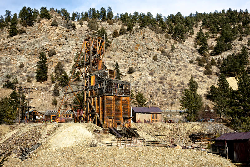 Remains of a Gold Mine. The weathered remains of a gold mine clings to a hillside in the American west royalty free stock image