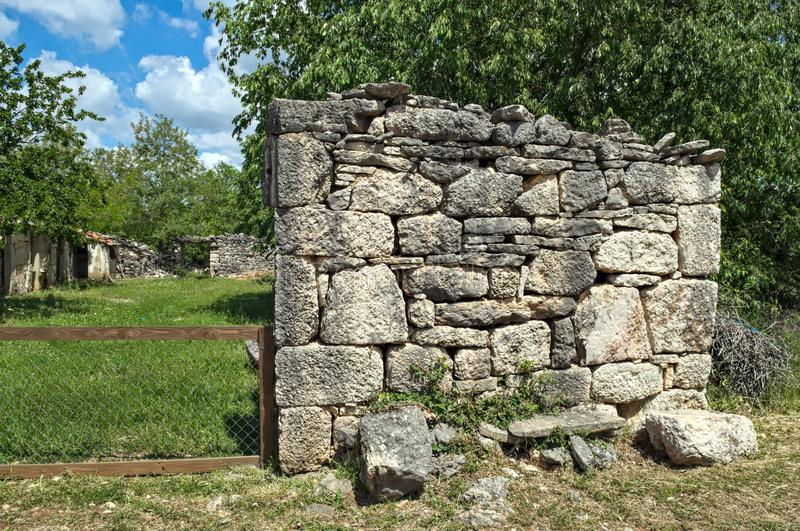 Remains of house stone wall in Dalmatia royalty free stock photos