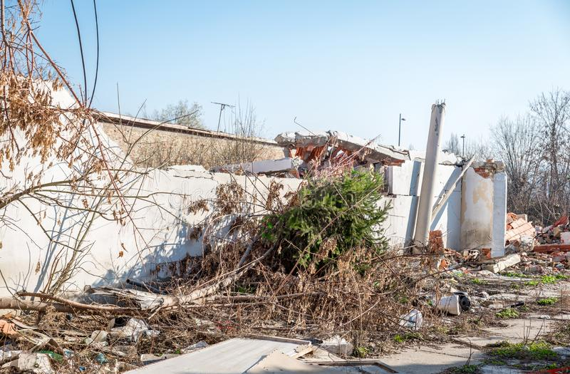 Remains of hurricane or earthquake aftermath disaster damage on ruined old houses with collapsed roof and wall stock image