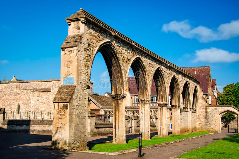Remains of infirmary arches at Gloucester Cathedral. Gloucester, United Kingdom - June 8, 2013: View of Remains of infirmary arches at Gloucester Cathedral stock image