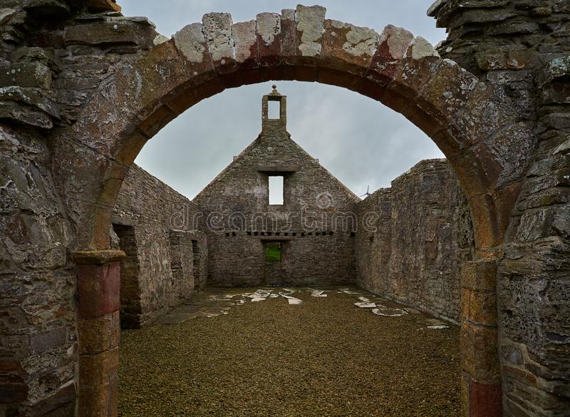 Remains of the Lady Kirk St Mary`s church in Pierowall`s graveyard, Westray, Scotland stock image