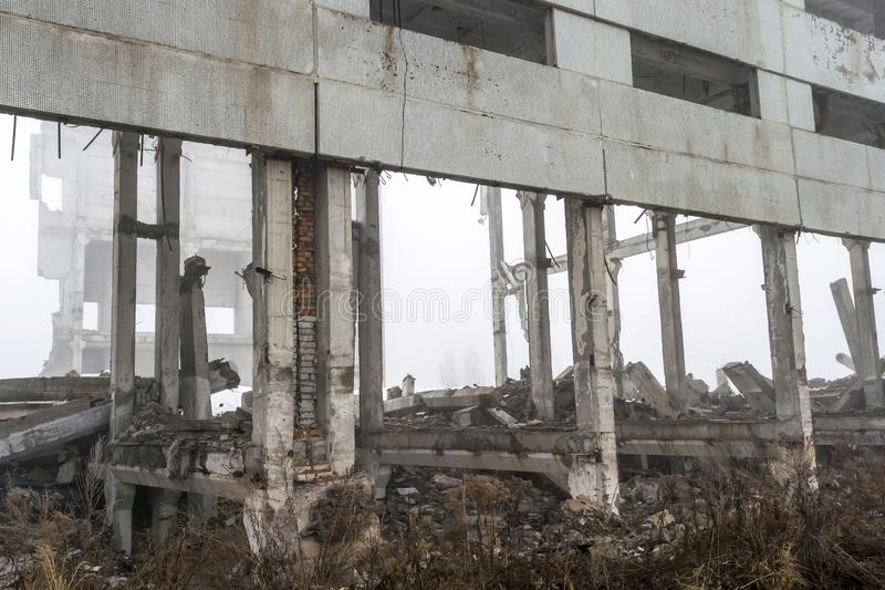 The remains of a large building destroyed in a foggy haze. Background. royalty free stock image