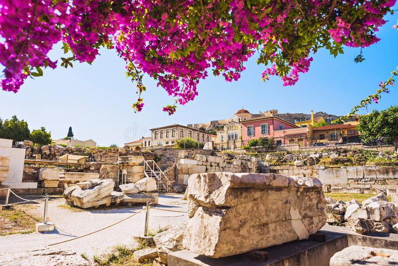 Remains of the Library of Hadrian, Plaka district and Acropolis in Athens old town, Greece. Famous landmark and popular travel des. Remains of the Library of stock image