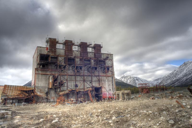 Asbestos mine. Remains of the main building of an abandoned asbestos mine in a breathtaking landscape in British Columbia. Shot as HDRI stock images
