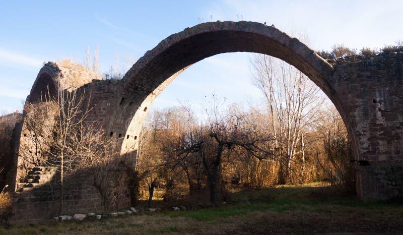 Remains of medieval bridge over Cardener river in Cardona. royalty free stock photo