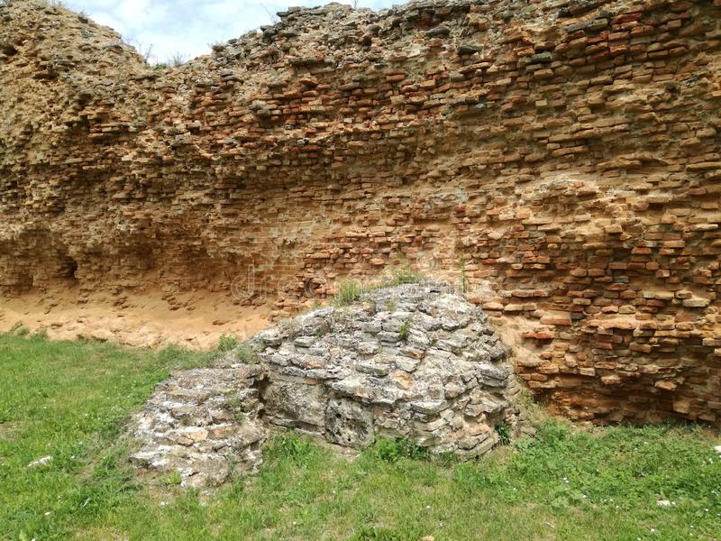 Remains of the medieval fortress ramparts on the inside. Remains of the medieval fortress. Ramparts on the inside, brick structure stock photos