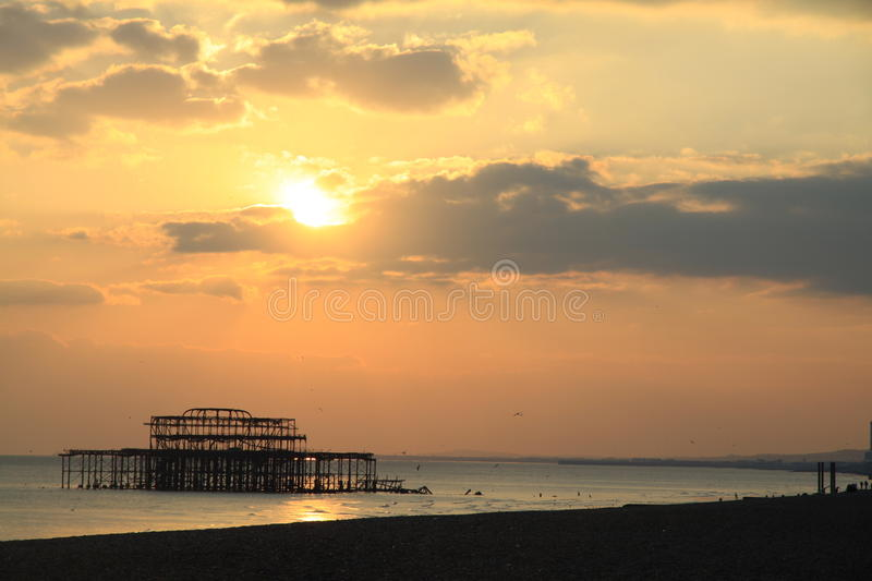 Remains of old Brighton Pier left standing in sea at sunset,, England, UK stock photography