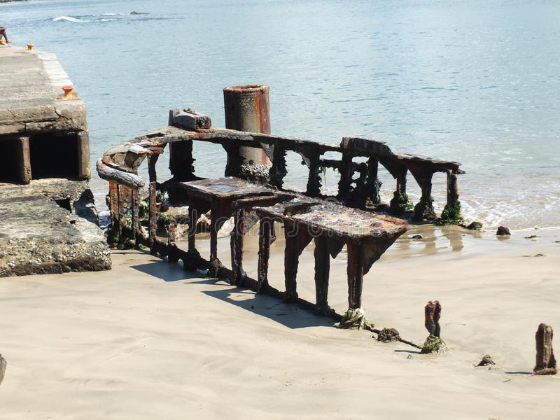 The remains of an old ship. Covered with sand in the water royalty free stock photography